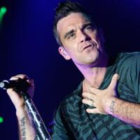 Leidybinę kompaniją pakeitęs Robbie Williams'as ateinančią vasarą pradžiugins nauju soliniu albumu